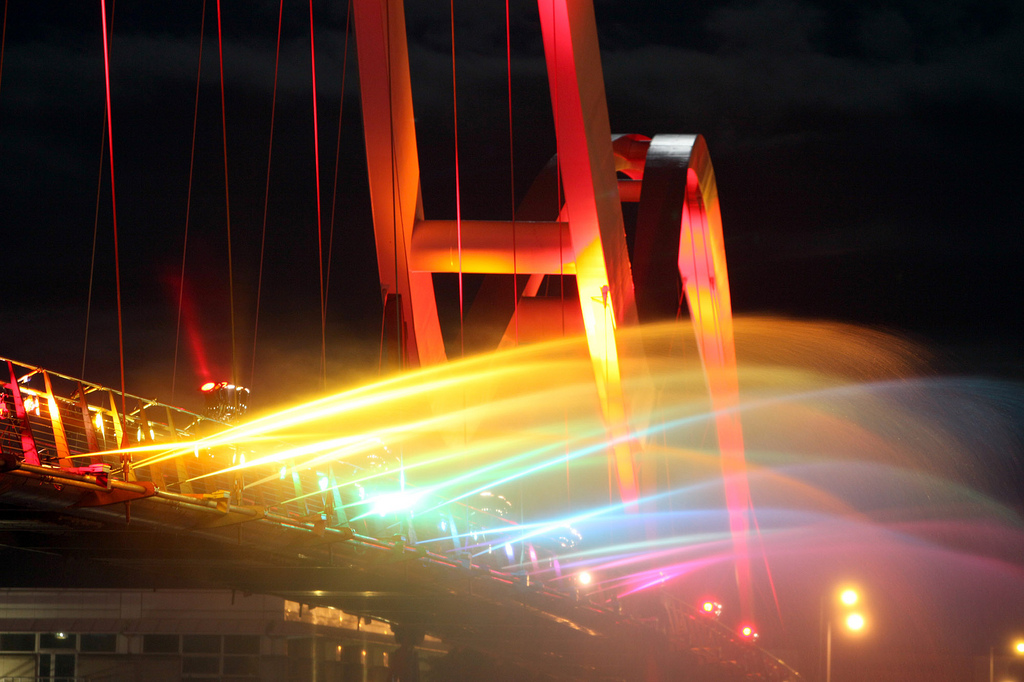 Taken: Saturday 14th May 2011 Stockton Infinity 2011 Festival with entertainment around the River Tees and on the iconic Infinity Bridge. Musicians , mobile fire and water structures were photographed as dusk falls, the bridge was dramatically transformed with a string of flames and magical illuminated fountains sending arcs of illuminated water into the River Tees. Photographer Byline: Dave Charnley Photography Mobile: 07753 559235